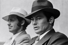 French actors Jean-Paul Belmondo and Alain Delon on the set of gangster movie Borsalino, directed by Jacques Deray in Paris, France, in September Get premium, high resolution news photos at Getty Images Alain Delon, Frances Movie, Gangster Movies, French Man, Famous French, The New Wave, Black Mask, Old Movies