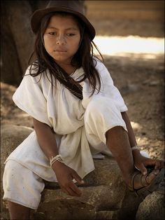 Arhuaco girl. The Arhuaco people are an indigenous people of Colombia. They are Chibchan-speaking people and descendents of the Tairona culture, concentrated in northern Colombia in the Sierra Nevada de Santa Marta.