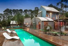 Narrow pool with wooden decking