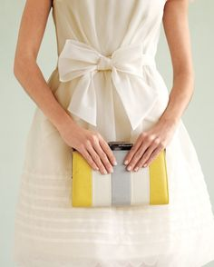 """For a barely there spin on stripes, put bridesmaids in Hitherto by Bhldn's """"Miraflores"""" frocks, and give them punchy Rachel Rachel Roy clutches as a token of thanks."""
