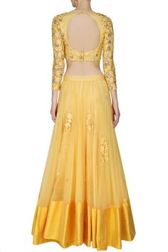 This set features a yellow lehenga in net base with threadwork floral motifs scattered all over and a broad silk border along the hem.#yellowcolorlehengacholi