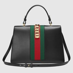 aa8f08e88cd Shop the Sylvie medium crocodile top handle bag by Gucci. The Sylvie bag in  a beautiful top handle shape with the nylon Web embedded under the  crocodile and ...