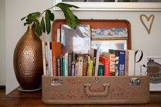 suitcase as book holder, perhaps with the kiddie ones in cute colours
