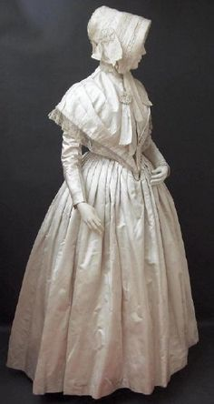 Wedding dress, silk satin with alternate long sleeves and cape to alter dress from evening into day wear, mid-late 1840s, English, via founder's collection.