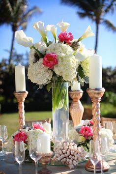 Centerpiece from Loly I want 3 floating candles instead of the pillars. The flowers will be hydrangea, coral and pink garden roses and peonies @glo