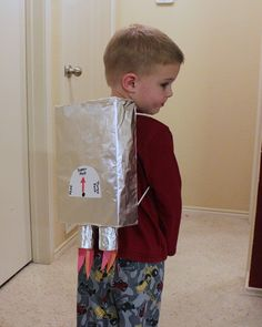 Make a Rocket Pack-now add helmets made of plastic milk jug containers. They can be easily cut into helmet shape by following the seams and removing the handle. Kids love this.