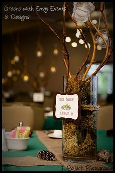 Elegant but natural centerpiece for summer camp themed event. Each table was labeled as a area of the summer camp (i.e. boys village, mess hall, ski dock, etc.)
