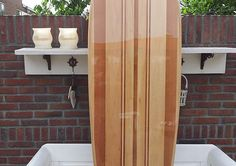 an overview of a wooden surfboard being built from start to finish Surfboard Fins, Wooden Surfboard, Wooden Paddle Boards, Outdoor Store, Wooden Diy, Tall Cabinet Storage, Furniture, Home Decor, Skate Surf