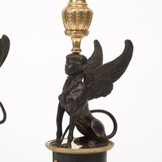 A PAIR OF RUSSIAN LOUIS XVI-STYLE 19TH CENTURY FIVE-LIGHT CANDELABRA. Gilt and patinated bronze. Height 58 cm.