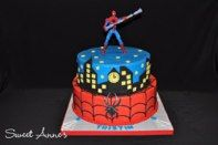Buttercream cake with fondant accents and a Spiderman topper!