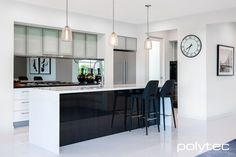 polytec - Overhead cupboard doors in ALUMINIUM 5mm/55mm Brushed Stainless frame with Frosted Glass insert. Drawers in CREATEC Ultra White. Bar panel in CREATEC Black Wenge.