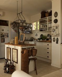 Callian, Antikt & Brocante- love the long basket and molds on the wall