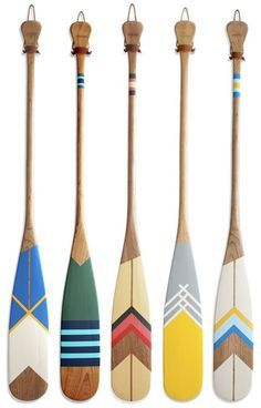 Painted wooden canoe paddles. Good idea for painting. Maybe with Pendelton blanket stripes behind it.