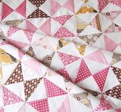 Here's a tutorial for that hourglass quilt I pinned before with the baby on it!  I guessed right...the squares are 5 inches...so fun to make.