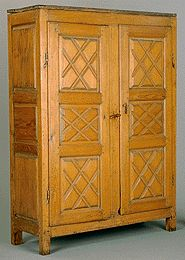 1700-1750 French-Canadian Armoire at the Canadian Museum of Civilization, Gatineau - This shows clearly the diamond/lozenge pattern that was popular in Canada in the 18th century.  At the time this piece was made, such decoration was already well out of fashion in France, where it was used in the reign of King Louis XIII.  However, what happened in French-Canadian pieces, rather than a switch from one style to the next, was an integration of elements from different stylistic periods.