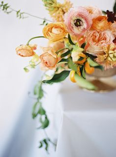 Light pink and orange floral wedding centerpiece in low vase with ranunculus, kumquats, and garden roses. Mod Wedding, Floral Wedding, Wedding Flowers, Wedding Blog, Dream Wedding, Ranunculus Wedding Bouquet, Wedding Bouquets, Bouquet Flowers, Peach Flowers