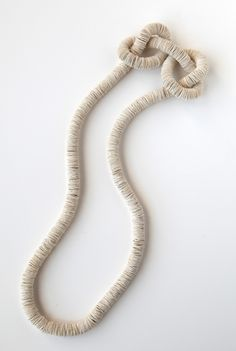 Kiff Slemmons presents her  paper jewelry which is highly sculptural and utilizes indigenous plants, fibers, as well as natural and synthetic dyes.