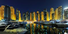 Dubai marina with its very expensive boats. This is the part of Dubai marina where exclusive parking is evident. Taken during the blue hour to gain the reflections from the lights