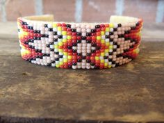 Check out this item in my Etsy shop https://www.etsy.com/listing/236984344/free-usa-shipping-seed-beads-native