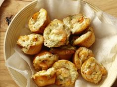 Recipe of the Day: Food Network Magazine's Easy Shrimp Puffs	 This simple, impressive and poppable appetizer starts with your mini muffin tin. Press store-bought refrigerator biscuits into the bottom, top with a creamy mix of shrimp, Monterey Jack cheese and scallions, then bake until each airy puff is golden and bubbling.