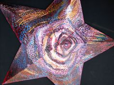 Rose Star a found object painting by Karin Fain copyright 2005. ALL RIGHTS RESERVED