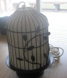 DIY light made from a bird cage...not sure I trust myself to do anything that potentially involves electricity, but I'm willing to give it a go for a result so stunning!