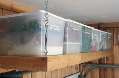 """11Reader Space: A Groovy Garage """"We hung 2 8 foot shelves over the garage door. Most people don't even know they have that storage space. They holds 10 tubs of Christmas decor perfectly."""""""