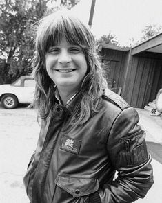 YOUNG OZZY OSBOURNE, smiling with long hair . HEAVY METAL T-SHIRTS and METALHEAD COMMUNITY BLOG. The World's No:1 Online Heavy Metal T-Shirt Store & Metal Music Blog. Check out our Metalhead Clothing and Apparel Store, Satanic Fashion and Black Metal T-Shirt Stores; https://heavymetaltshirts.net/