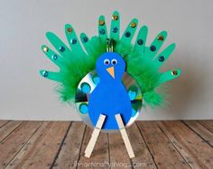 CD Peacock Turn your handprints and an old CD into an eye-catching peacock! This colorful craft is so much fun! The post CD Peacock was featured on Fun Family Crafts. Kids Crafts, Family Crafts, Toddler Crafts, Projects For Kids, Crafts To Make, Craft Projects, Arts And Crafts, Summer Crafts, Craft Ideas