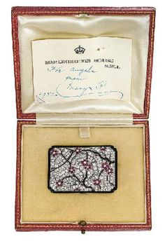 A beautiful diamond, ruby, and onyx brooch by Lacloche Frères. Circa 1925.