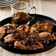 These oven-fried chicken breasts are accompanied by a gravy that gets a ton of flavor from strips of caramelized onion.