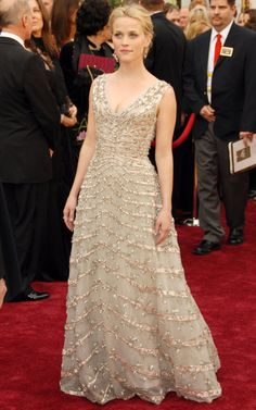 Reese Witherspoon in Vintage Dior at the 2006 Oscars: http://aol.it/1hPLQgy. Love Reese, she's is thinking in this picture.