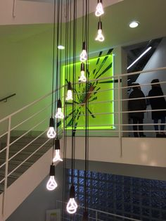 Plumen 001 designer light bulb cascading down the Design Museum stariwell