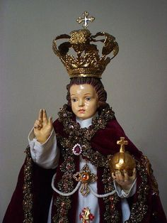 The holy infant wearing his vintage sacerdotal vestments- a set once worn by a miraculous image of a bishop-saint venerated somewhere south of the Philippines.  personal collection