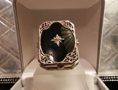 SOLD! This Sterling Silver Ring is an original Art Deco Ring. The workmanship on this 1920's handmade ring is beautiful. The filigree style is very typical of the period, however this is a much larger ring that is usually found in Art Deco jewelry. It is currently a size 7.5 but would be easy to resize. $175 free shipping  in the U.S.!  To Purchase with PayPal,Check, or money order email Lisa@LisaLePaige.com