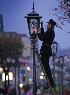 The tradition of lighting lamps manually in Brest, Belarus. Come and see on our Brest tour! Lantern Lamp, Candle Lanterns, I Saw The Light, Light Up, Beautiful Streets, Foto Art, Street Lamp, Antique Lamps, Street Furniture