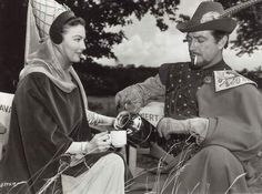 "Ava Gardner & Robert Taylor take a coffee break on the set of ""Knights of the Round Table""."
