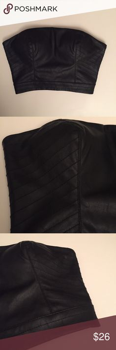 Bebe faux leather black tube top XXS new Brand new without tags Bebe faux leather black tube top size XXS. Wear over a white button down top for a hot look! bebe Tops