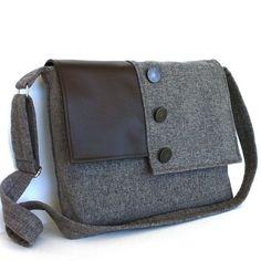 Love the style of this bag  https://www.etsy.com/listing/185993959/large-messenger-bag-cross-body-laptop