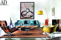 The #living room of the #Bengaluru home of #architect Sandeep Khosla and his wife Tania Singh Khosla, a #graphic #designer. @crateandbarrel coffee #table, #artwork by Atul Dodiya, #Eames #chair.  Photographer: Tom Parker