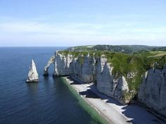 The cliffs at Etretat are part of the Alabaster coast in France. In this seaside town you can have a great view of the white cliffs and the natural archways that reach out into the sea. You can enjoy the view of the 70 m high limestone cliffs with a walk on the paths leading from the beaches.
