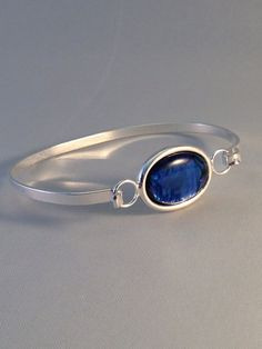 paua shell bangle in a stunning blue colour by BrowniesCRAFTBOX