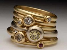 gold pebble jewelry with diamonds by Malcolm Morris