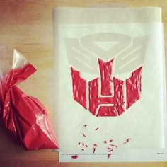Awesome decorating tip - print logo and place parchment paper on top.  Then trace design.