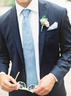 Navy suit, pale blue tie