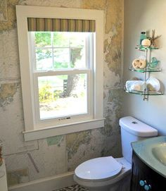 DIY nautical chart wallpaper... to create a stunning accent wall in your bathroom: http://www.completely-coastal.com/2016/04/wall-treatment-ideas-for-bathroom.html