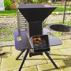 """If Rorschach were a grillin' man, the Watchman Stove is what he'd use. This outdoor cooker can make multiple face changes too, with 2 primary cooking options, plus a warming """"Potato Plate,"""" plus any new ways of using the stove you come up with while you Outdoor Cooking Stove, Outdoor Stove, Metal Projects, Welding Projects, Rocket Stove Design, Parrilla Exterior, Diy Wood Stove, Cooking Stone, Multi Fuel Stove"""