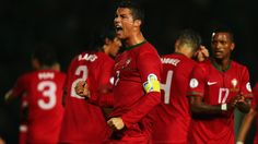 BELFAST, NORTHERN IRELAND - SEPTEMBER 06: Cristiano Ronaldo of Portugal celebrates scoring during the FIFA 2014 World Cup Qualifying Group F match between Northern Ireland and Portugal at Windsor Park on September 6, 2013 in Belfast, Northern Ireland. (Photo by Bryn Lennon/Getty Images)