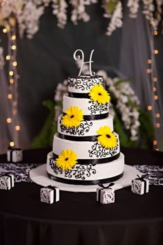 Damask and Yellow Wedding Cake. Imagining with deep red roses instead of yellow flowers