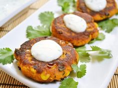 Cumin, cilantro, and cayenne pepper add big flavor to these savory Sweet Potato Corn Cakes. Dip them in the creamy garlic sauce for even more zing!